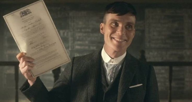 A rare photo of Tommy Shelby smiling