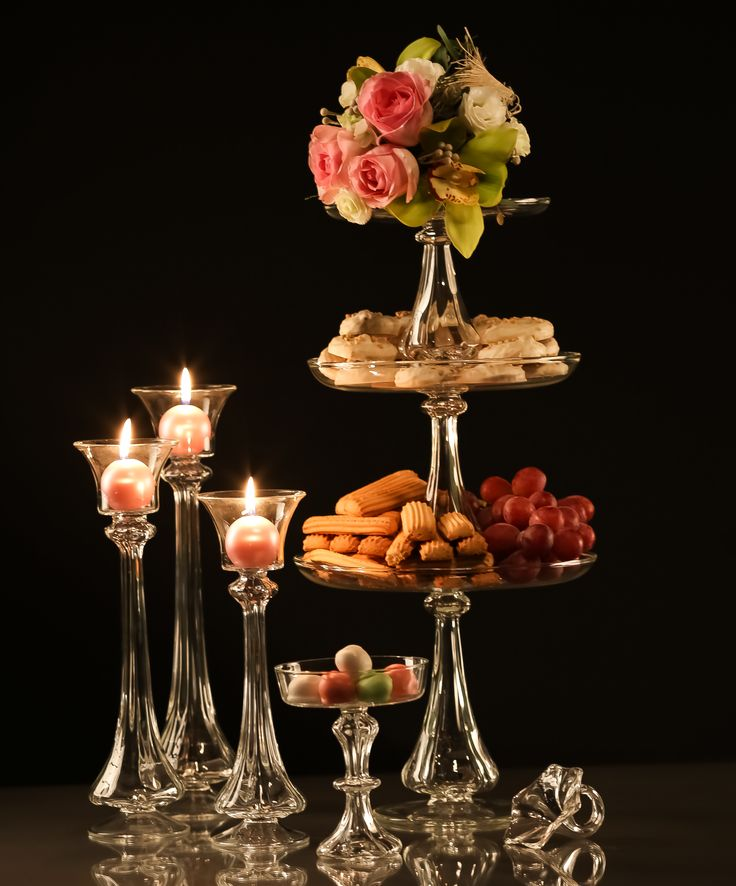 Cake stands, fruit stands and candleholders - glassware for wedding decoration.