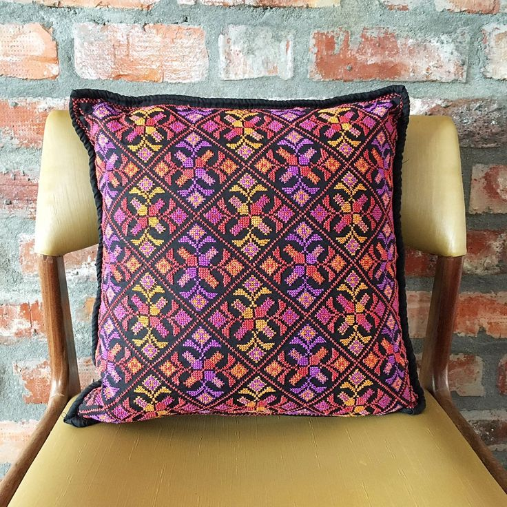 "Meticulously hand embroidered in Egypt on luxurious Egyptian cotton, this cover is named after the Irish goddess Brigid ~  ""the goddess whom poets adored"".  Black with purple, and bright & burnt orange  accents. Perfect pop of colour!  40cm x 40cm.   Free delivery within South Africa."