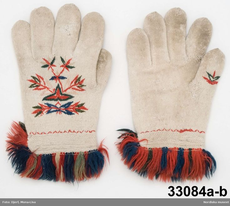 Twined knitted mittens with embroidery and crocheted parts as well.  Where worn during weddings and in church.  Äppelbo, Sweden.