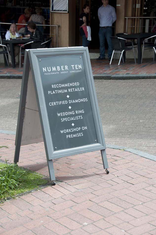 A board pavement advertisement signage #sandwich board, #sidewalk sign #pavement sign