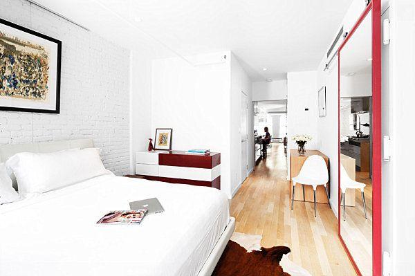 Mirrored barn door in a contemporary bedroom 10 Rooms Featuring Sliding Mirror Closet Doors