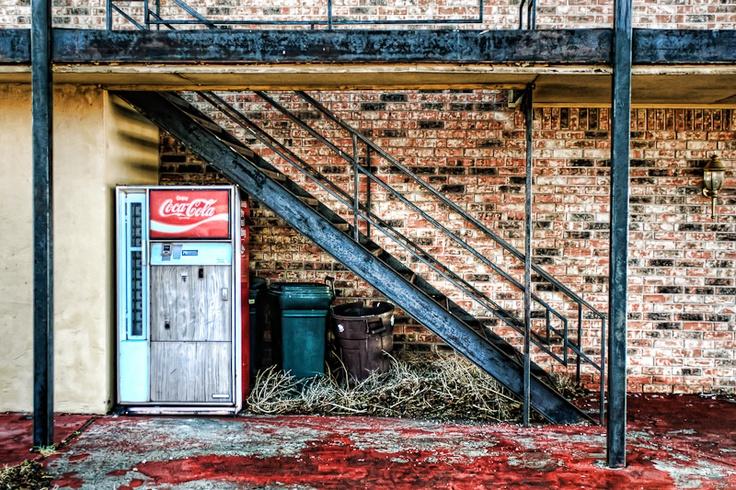 An old Coca-Cola vending machine outside a roadside motel in Adrian, Texas.