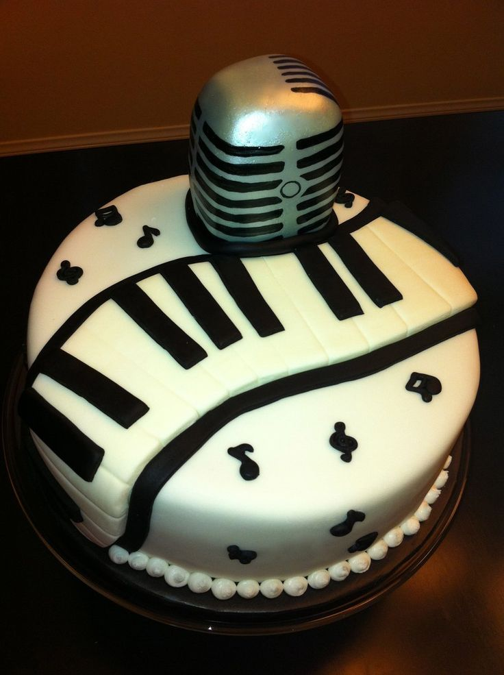 Musical Birthday Cake The microphone is a mini carved cake. I airbrushed it with silver then painted on the black. The music notes are from...