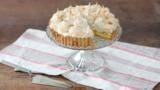 The traditional lemon meringue pie is given a tropical twist with lime and coconut.  For this recipe you will need a 20cm/8in loose-bottomed flan tin, a sugar thermometer, a freestanding mixer fitted with a whisk attachment and a large piping bag fitted with a large star nozzle.