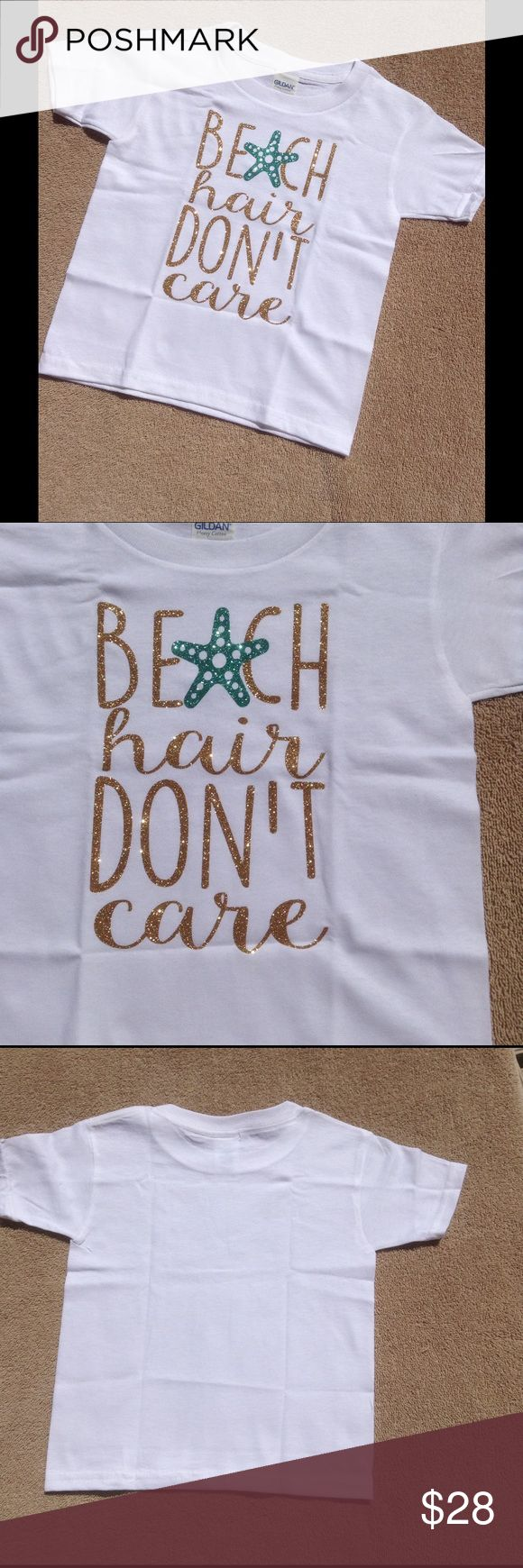 HPBeach Hair, Don't Care Kids Tee This adorable tee features a gold glittery appliqué with a teal green starfish. Perfect for your little beach goer. 100% soft cotton. Gildan brand. Since this is retail, it has no tags. Made exclusive for Sandystarfish. Sandystarfish Shirts & Tops Tees - Short Sleeve