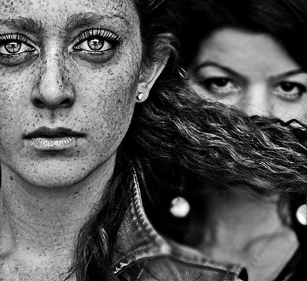 Diane Arbus created this awesome picture by focusing on the main subjects freckles and glistening eyes. She also adds a mysterious and sneaky affect by including the girl in the background hiding behind the subjects hair.