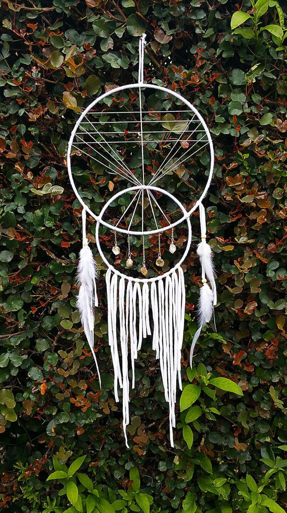 Standard dream catcher in upper crescent shape, pyramid in center eye (as above), crystals in small crescent (as above). Feathers hang from beneath.