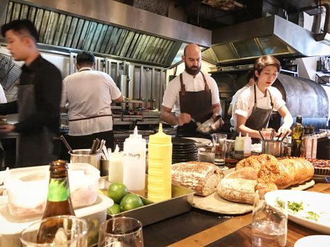 Chef Dave Pynt cooking in the kitchen at Burnt Ends Singapore!                        Burnt Ends Singapore Restaurant BBQ Modern Australian Barbecue Asia's 50 Best Restaurants World's 50 Best Restaurants Restaurant Review Chef Dave Pynt Cooking Counter Seats Kitchen View