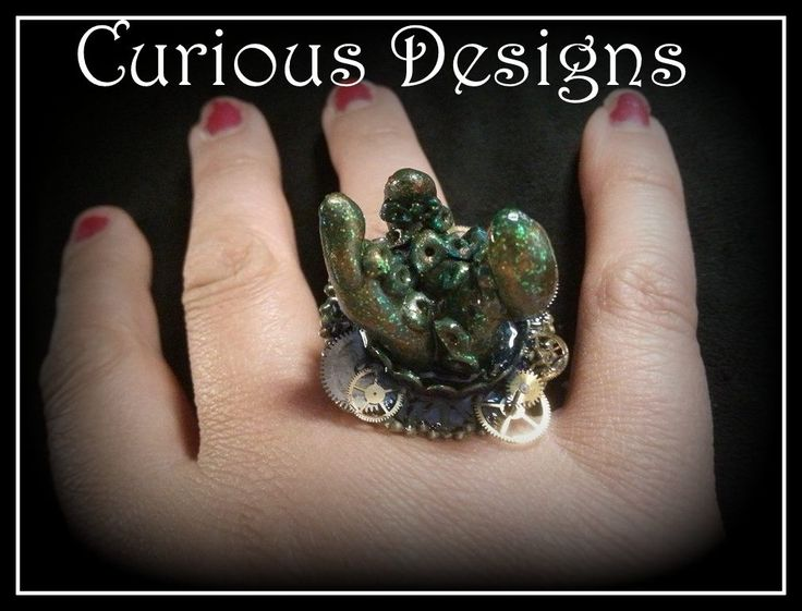 Kraken Tentacle ring The tentacles are erupting from water and have a cog detail round the edge. This is a story piece and you can follow it at http://ladyopheliaravenlovelace.blogspot.co.uk/ #ladyopheliaravenlovelace #curiousdesigns #kraken #water #ring #cogs #steampunk #tentacles