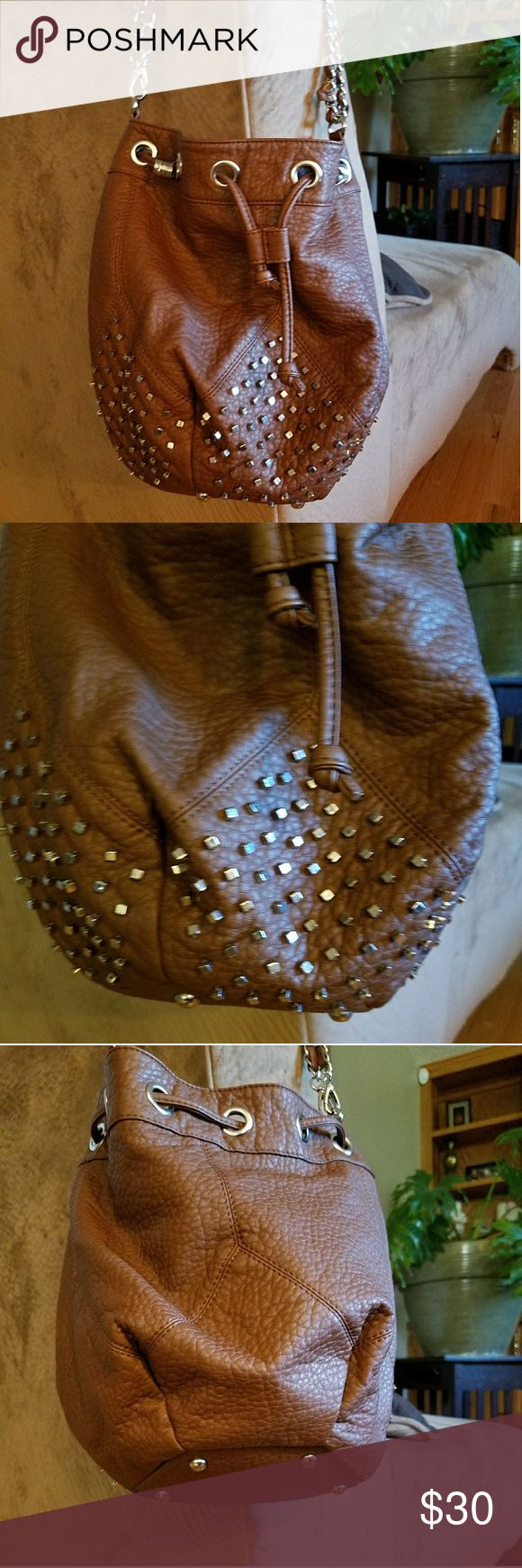DEENA AND OZZY STUDDED BAG Cute carmel brown, faux leather drawstring bag with silver studs and hardware. Has detachable shoulder strap and a silver chain strap. Never used, NWOT Deena & Oozzy Bags Crossbody Bags