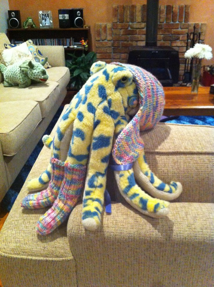 "Baby socks & hat modelled by ""Cuddles the Octopus""."