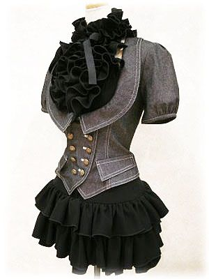 I'm not a big fan of the extreme ruffles at the neck but I love the jacket and slight skirt,