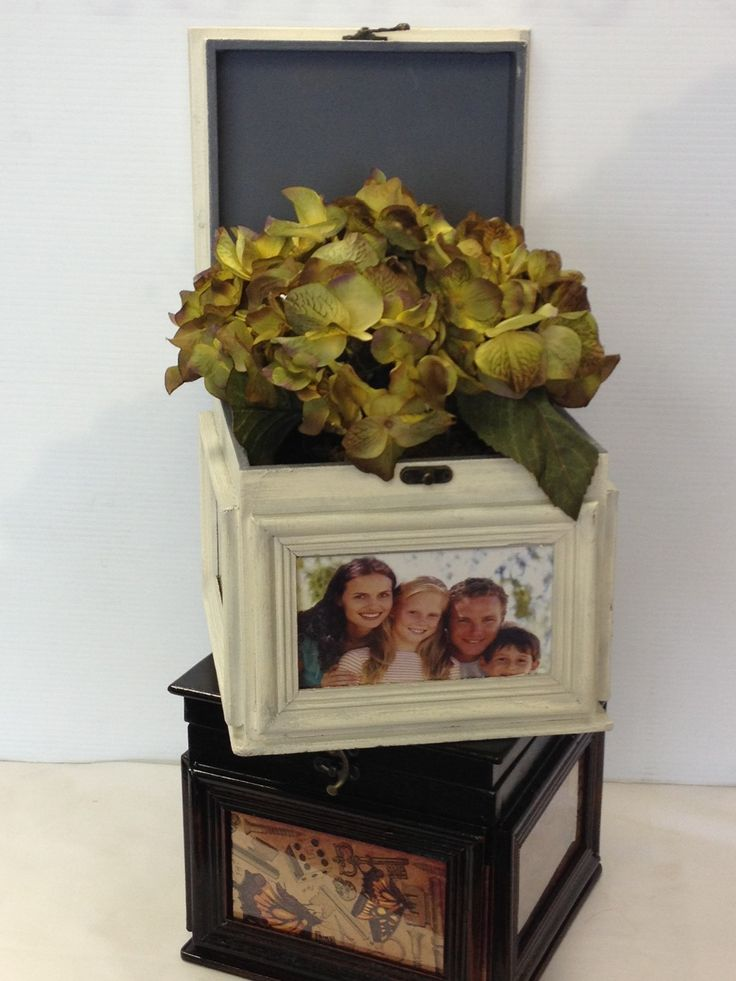 These photo boxes and have 3 4x6 slots for photos you can add. They can be done with fresh flowers or plants. Great for anniversaries, memorials or birthdays