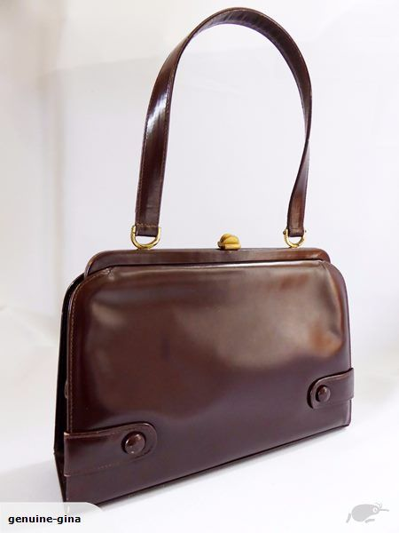 One of the earliest Hermes NZ bags out there. Circa 1950. Hermes NZ is owned by Briarwood and has been operating for over 65 years. In very tidy condition. Cute buttons on front. With open and zipped side pockets. 25 cm x 17 cm.