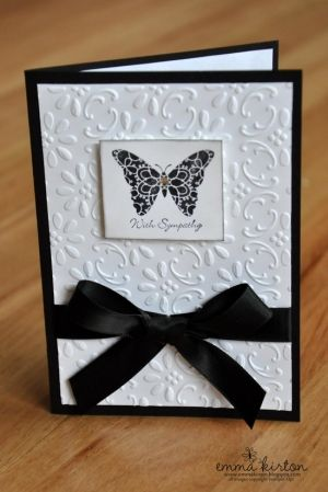 handmade sympathy card ... black and whie .. embossing folder texture ... wrapped in black ribbon ,,, small focal point with butterfly and sentiment ... elegant and simple ...:
