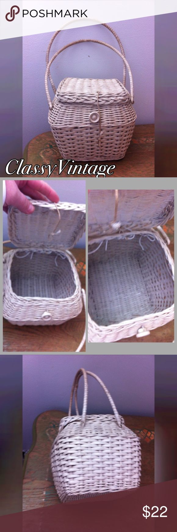 Stinking cute vintage basket handbag White wicker basket bag. Double handles attached lid. Wood button and elastic loop closure. Shabby chic at its best. Not lined no tags . Shows some wear but is expected and really looks good that way. She is 7 inches tall and each side is 6.5 wide. Vintage Bags