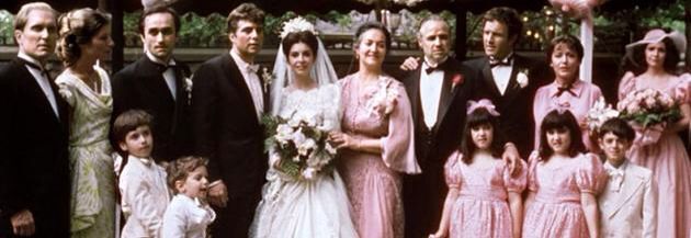 """THE GODFATHER MARRIAGE SCENE~ The Corleone family at the wedding of Constanza Corleone and Carlo Rizzi. From L to R: Tom Hagen, (adopted son and consigliere), his wife Theresa, Alfredo (Fredo) the youngest son, the bridegroom, Carlo Rizzi, the bride Connie Corleone, Mama Corleone. Don Vito Corleone, Santino """"Sonny"""" Corleone, the eldest son, and his wife, Sandra. Sonny's mistress, Lucy Mancini, the mother of his illegitimate son, Vincent Corleone"""