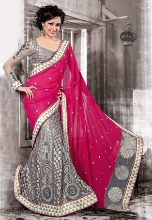 Dark pink and grey faux georgette, net and viscose lehenga style saree designed with resham, zari and patch border work. Available with grey viscose blouse fabric which can be customized from 32 to 42 inches, blouse shown in image is for photography purpose only. (Slight variation in color and patch border is possible.) data-pin-do=