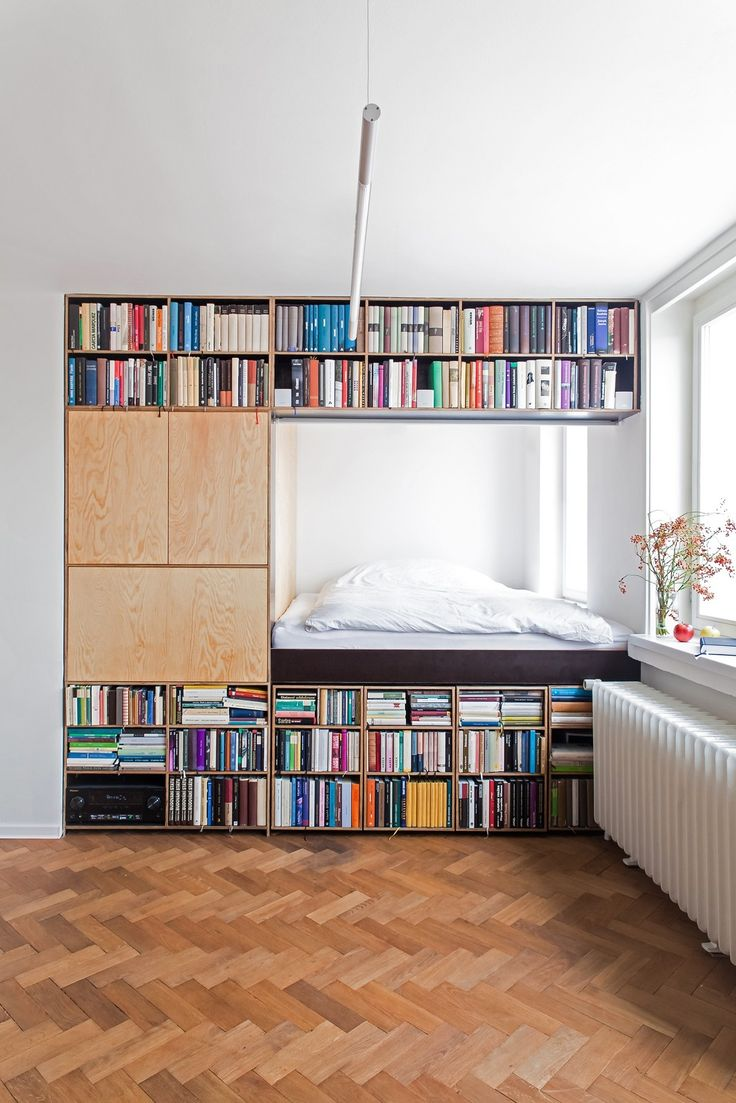 BY Architects has slotted the bed behind a massive bookshelf.