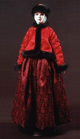 """Prascovia    Prascovia's costume is an ethnographically exact winter costume traditional for peasant woman, of Arkhangelsk Province (second half of the 19-Th century).    Biscuit porcelain, silk, hand embroidery, hand painting.    Limited edition of 125; 22,5"""" tall  BY ALEXANDRA KOUKINOVA ART DOLLS"""