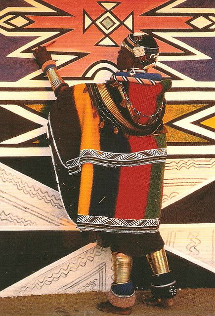 Ndebele tribal wear, South Africa..Incredible patterns and colors...golden leg bangles
