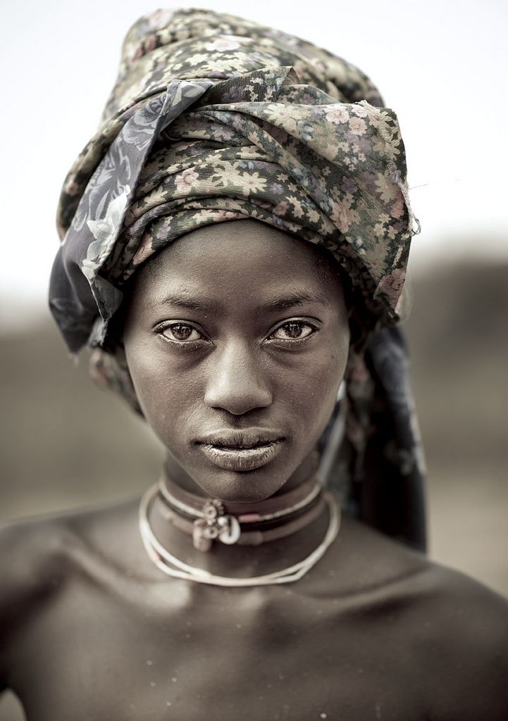 theiainteriordesign:  Mucubal tribe beauty - Angola (Eric Lafforgue) A Mucabal girl without the giant headwear! Mucubal (also called Mucubai...