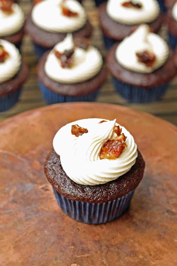 Chocolate Coffee Cupcakes with Whiskey Buttercream Frosting and Candied Bacon | honeyandbirch.com #dessert