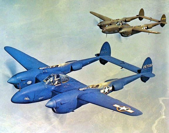 F-5B-1-LO Lightning aircraft (photo reconnaissance variant of the P-38J) painted in sea blue color scheme in flight, 1943; photo 2 of 2; note accompanying P-38J aircraft in usual olive drab