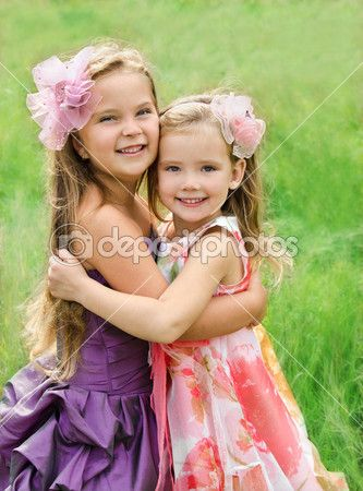 Portrait of two embracing cute little girls — Stock Image #13846502