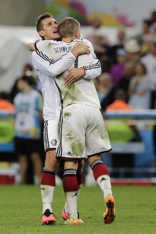 Germany's Bastian Schweinsteiger and Miroslav Klose, left, embrace after the World Cup final soccer match between Germany and Argentina at the Maracana Stadium in Rio de Janeiro, Brazil, Sunday, July 13, 2014. Germany won the match 1-0. (AP Photo/Matthias Schrader)