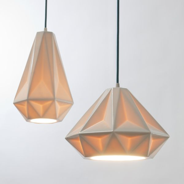 Aspect Pendant Lamps by Schmitt Design. The faceted forms of the Aspect Pendants are modern, yet timeless. The lamps are slip cast in translucent porcelain, resulting in a warm glow as light is diffused. Winner of the 2012 Dwell on Design Award for Best Lighting.
