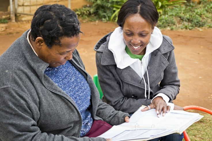 iThemba Educational Fieldworker Wendy sits with the teacher at Siyazama creche and discusses the curriculum.