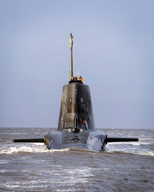 Royal Navy submarine HMS Astute sails up the Clyde estuary into her home port of…