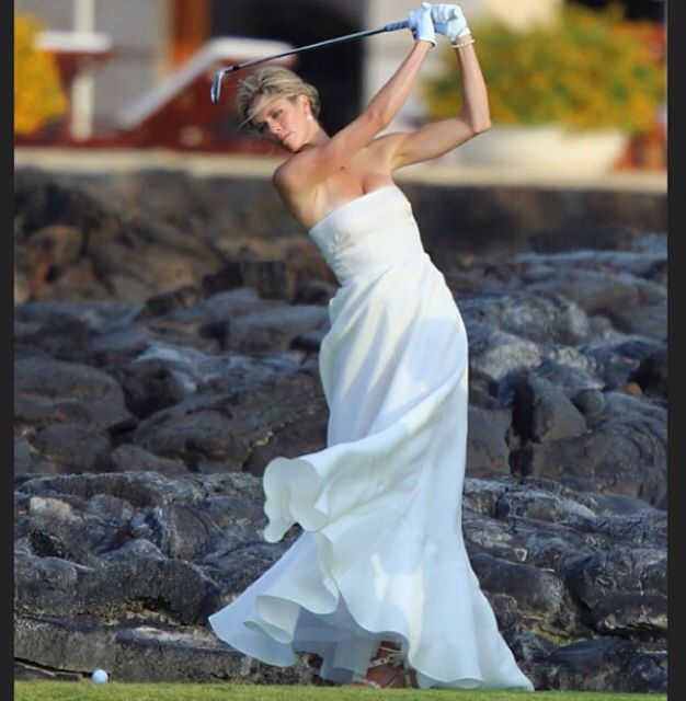 Bride golfer... my friend did this with hockey gear!  So cute and her hubby loved it!