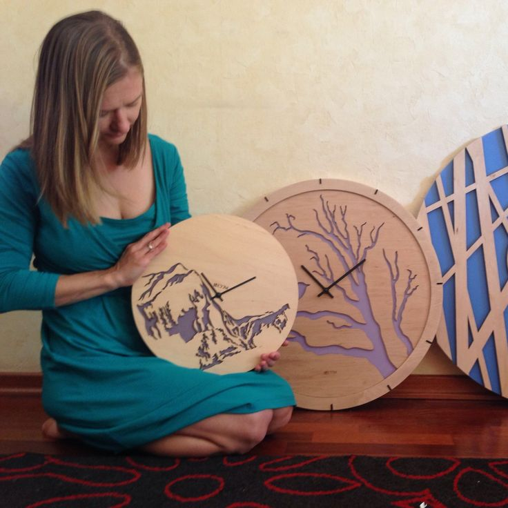 Our designer and creator with her clocks