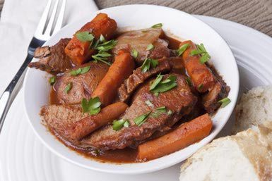 Beef Brisket with Vegetables and Country Bread - Kirbylng/E+/Getty Images