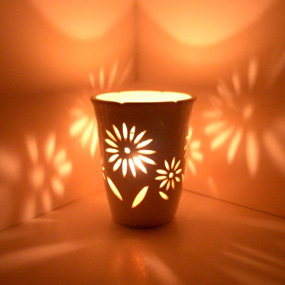 wheel thrown ceramic candle holder - cut out designs ...