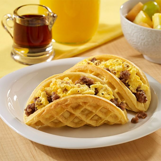 Sausage and Egg Waffle Tacos. Now that's a major yum yum breakfast idea! Recipe featured on The Casual Craftlete.