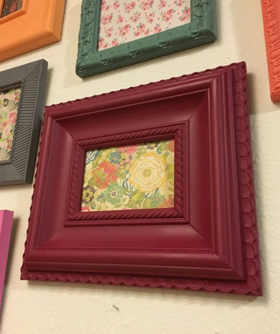 First off, let me just say that this frame is FABULOUS! This is an upcycled, wood photo frame that I painted a cranberry red and finished with a matte sealant. The frame holds a 4x6 photo and has an awesome outside size of 10.5x12.5. Super chunky! There is no easel with this frame so it can only hang on a wall. But I added all new backing and hardware to make switching out photos easy. There are also 2 sawtooth hangers so you have your choice in hanging direction. No glass is pictured but it…