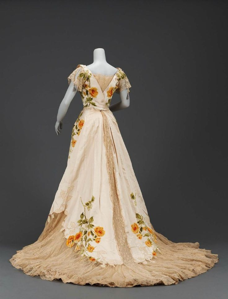 MFA: Woman's dress in two parts      French, about 1902      Designed by Jean-Philippe Worth, French, 1856–1926      For House of Worth,      Paris, France  Dimensions      Bodice: 48.3 cm (19 in.); Skirt: CB 177.8 cm (70 in.) Other (skirt CB): 177.8 cm (70 in.)  Medium or Technique      Silk, voided velvet with satin ground; appliquéd and trimmed with chenille and rhinestones; machine-made lace