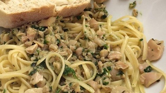 A splash of white wine and a sprinkling of basil simmer right along with garlic, parsley and clams, enlivening the basic sauce for this delightful clam linguini.