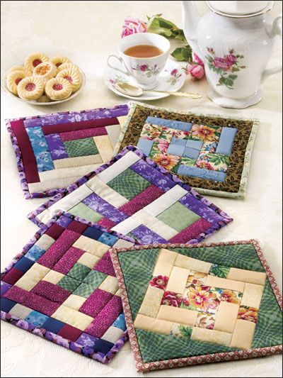 Homemade quilted potholders - fun way to individualize kitchen.
