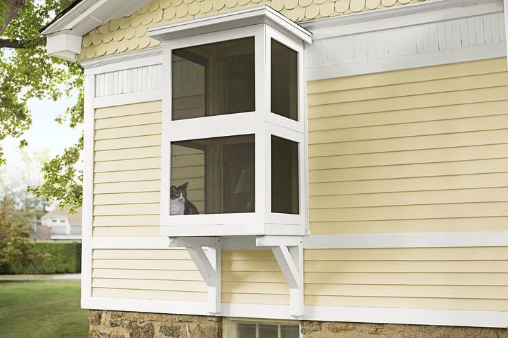 Use basic cedar lumber to create a screened-in patio space that gives cats a breath offresh air while keeping them close to home