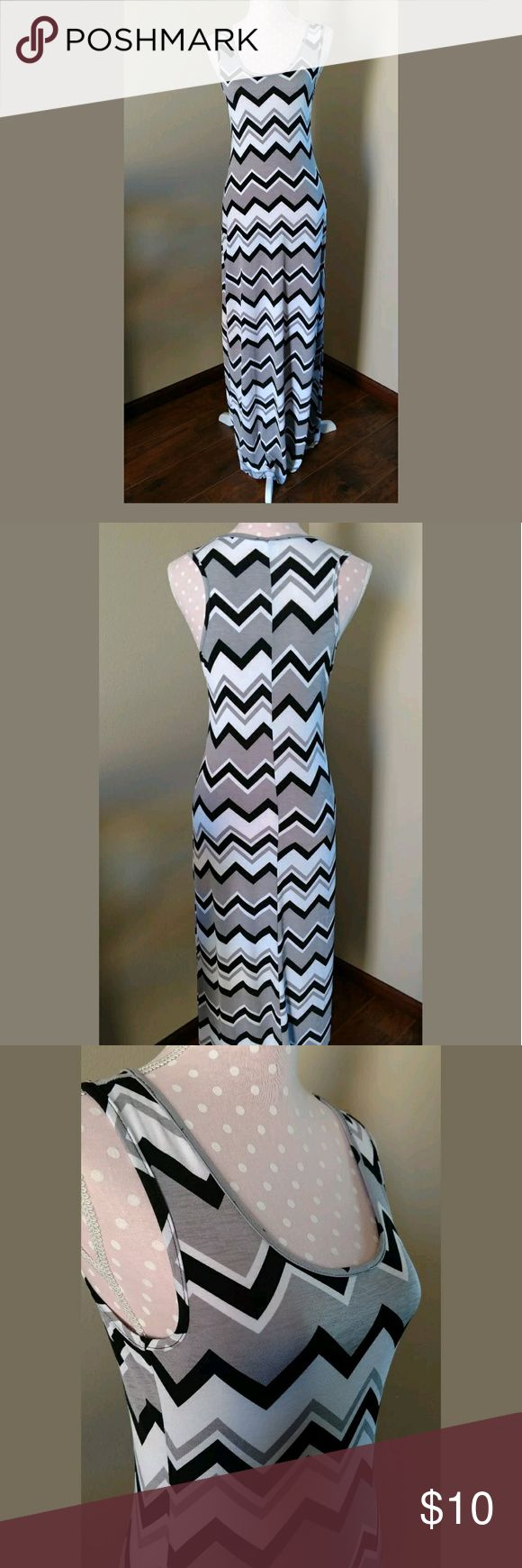 """Gray Chevron Maxi Dress Medium Ladies Maxi Dress. This dress is in excellent pre-owned condition. Gray black and white chevron pattern. Sleeveless. Polyester spandex fabric. The tag is unreadable for me so I do not know where it was made. or the brand.  Size medium. Across the chest is 16"""" un-stretched and from the shoulder to the hemline is 56"""". Dresses Maxi"""