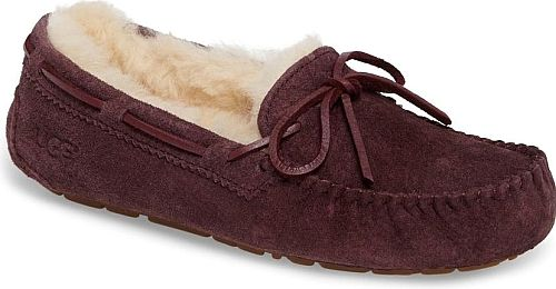 UGGR Women's Shoes in Port Suede Color. Metallic-finish laces add eye-catching gleam to a fan-favorite moccasin slipper from UGG fitted with a flexible rubber sole for indoor/outdoor versatility. The plush lining is crafted from UGGpure, a textile made entirely from wool but crafted to feel and wear like genuine shearling.