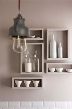Shelving ~ Quick and easy organization...making a design statement....painting/wall papering the back would be a WOW factor to the shelving.