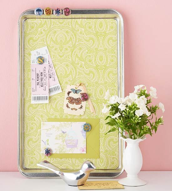 Beautiful Magnetic Board  Update an old cookie sheet as a magnetic bulletin board for a quirky way to display treasures. Glue a bright piece of wrapping paper to the inside of a cookie sheet. Fun magnets make it easy to embellish the board when hanging mementos