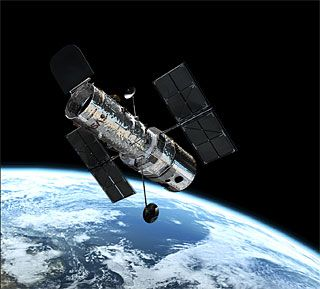Google Image Result for http://www.spacetelescope.org/static/about/img/hubble_in_orbit1.jpg