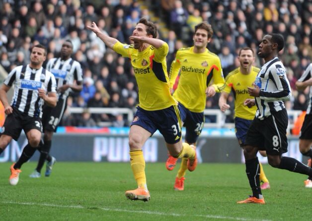 Fabio Borini celebrates putting Sunderland ahead against Newcastle at St James's Park in today's Tyne-Wear derby, after scoring from the penalty spot.